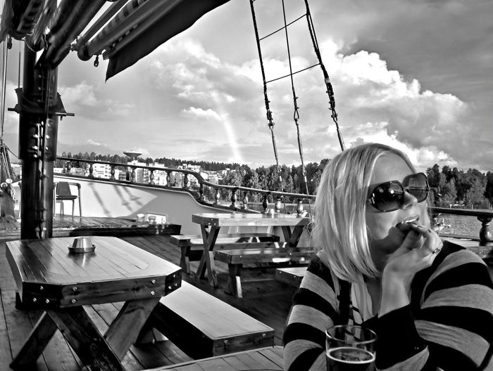 Woman eating food on ship