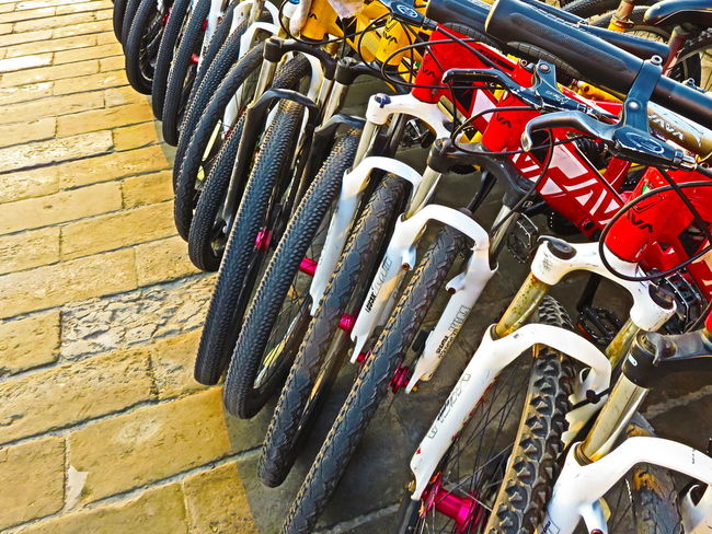 Bicycles close-up on City wall in Qi'an China Bicycles China Close-up Manipulated Mountain Bike Qi'an Tourism Transport