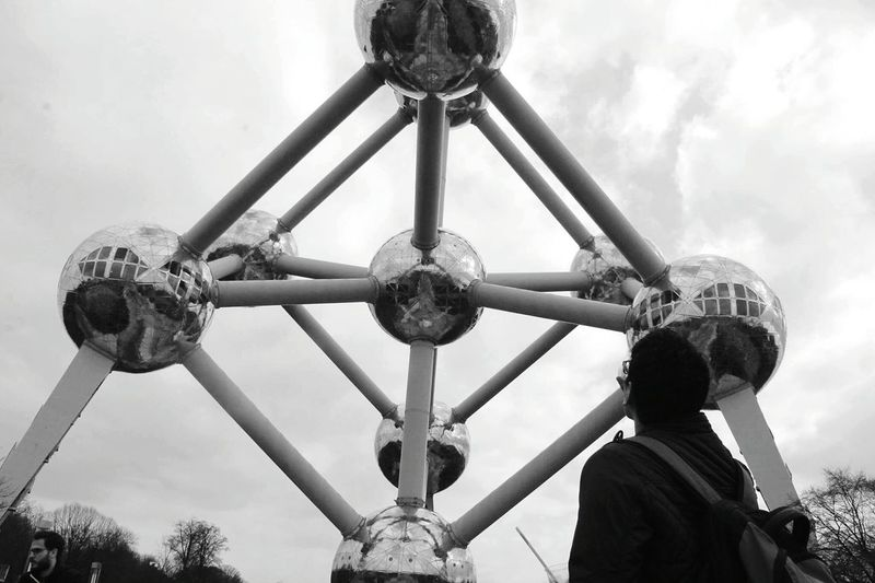 Rear View Of Man Looking At Atomium