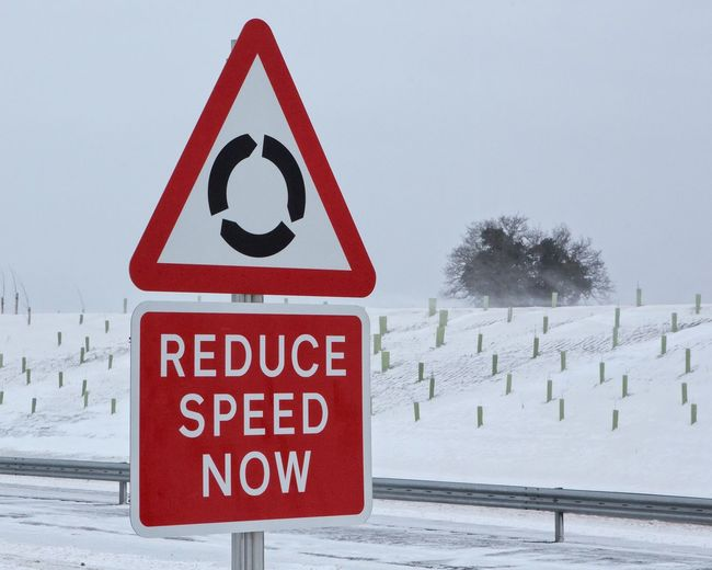 Care in the Snow Slow Down Speed Highways&Freeways Roundabout Norwich Spixworth Norwich Distributor Road Ndr Norfolk Uk Beast From The East Red Sign Communication Snow Warning Sign Cold Temperature Road Sign Winter Safety Road