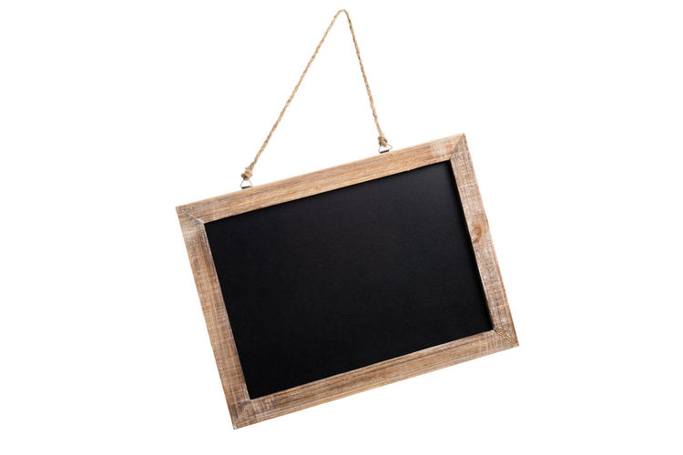 Close-Up Of Blackboard Over White Background