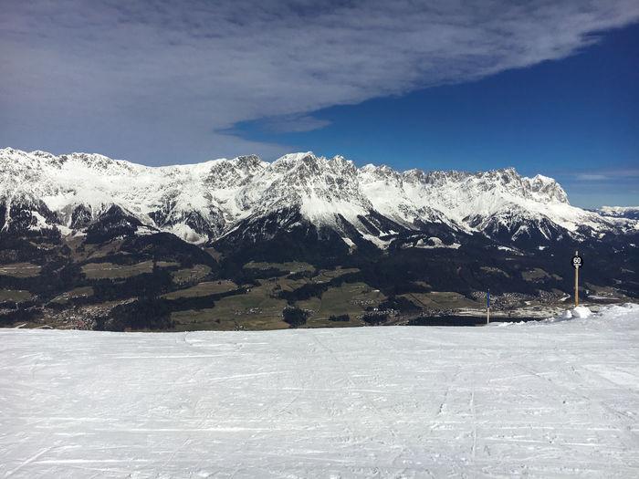 Snow covered wilder kaiser mountain against sky
