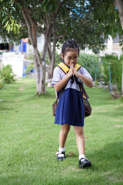 Khwan Khaw after school. Student Thai Thailand After School Casual Clothing Child Childhood Day Females Front View Full Length Girl Girls Grass Innocence Kid Land Leisure Activity Lifestyles Nature One Person Outdoors Plant Pre-adolescent Child Real People Standing Student Uniform Tree Unifrom Women Young Adult The Portraitist - 2018 EyeEm Awards The Fashion Photographer - 2018 EyeEm Awards The Still Life Photographer - 2018 EyeEm Awards
