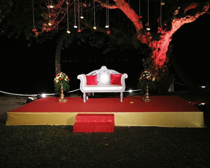 Decorated, open-air, empty wedding stage set-up. Wedding Reception Decoration Open Air Event Wedding Party After Wedding Ceremony Simple Minimal Decorations Stage No Bride And Groom Set Up Wedding Sofa Wedding Venue Reception Hall Goa Bay 15 Dona Paula No People Outdoors
