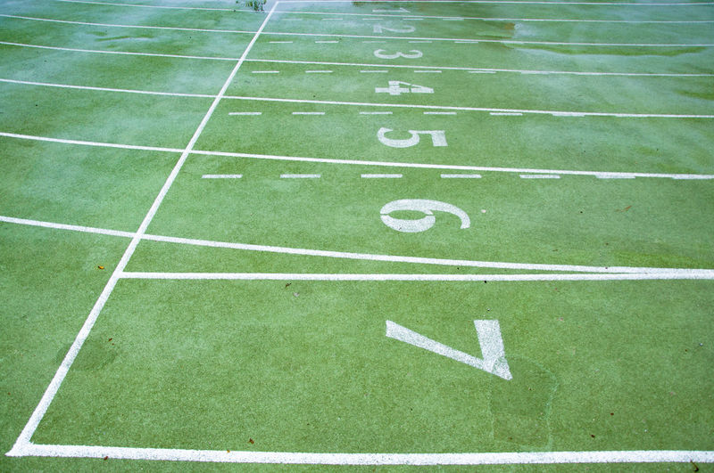 Soaked race track starting grid Lines Curves Geometry Racetrack Soccer Field Sport Playing Field Stadium Competitive Sport Running Track Close-up