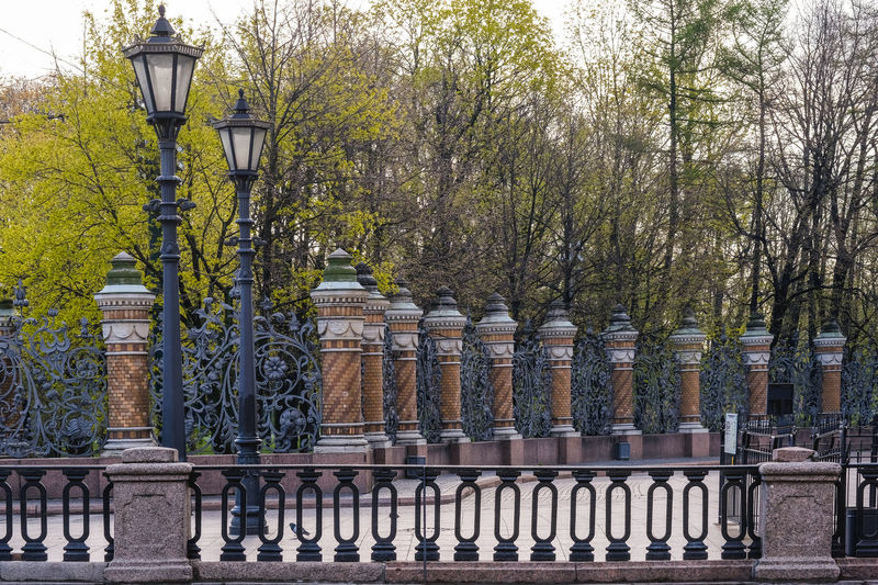 Tree Street Light Lighting Equipment No People Day Plant Nature Architecture Street Railing Outdoors Built Structure History The Past In A Row Metal Building Exterior Architectural Column Old Boundary Electric Lamp Balustrade