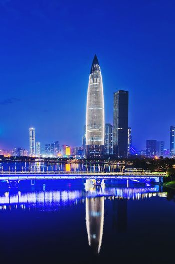 China Resources Building Shenzhen Bay Park Shenzhen Talent Park Shenzhen Building Exterior Built Structure Architecture Sky Water Illuminated City Building Night Blue