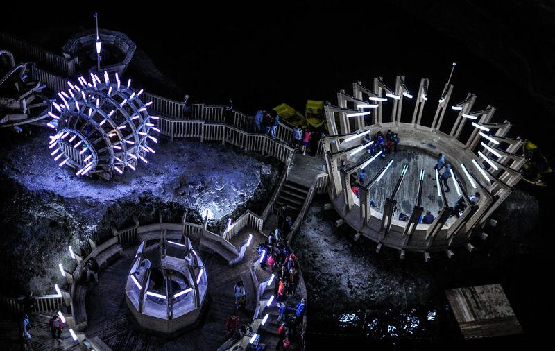 High angle view of illuminated amusement park at night