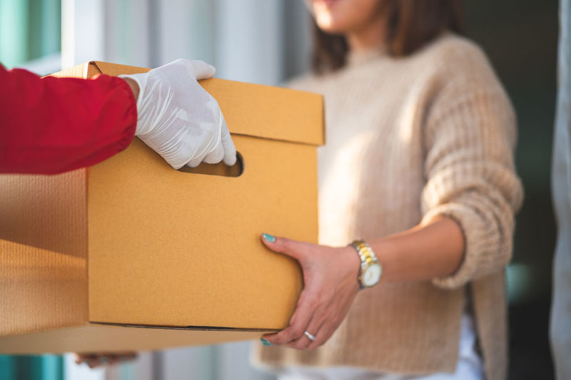 Close-up of woman working in box