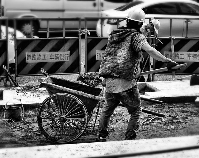 Working around the Clock Up Close Street Photography Taking Photos Streetphotography Street Workers Respect Work Hard Road Construction Salute Work With Poise Guangzhou Tianhe Road Blackandwhite Blackandwhite Photography