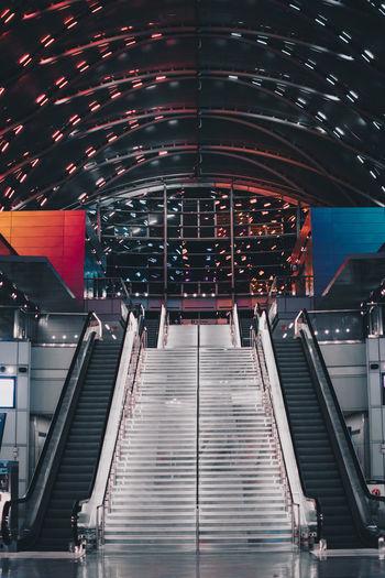 Low angle view of illuminated escalator at subway station