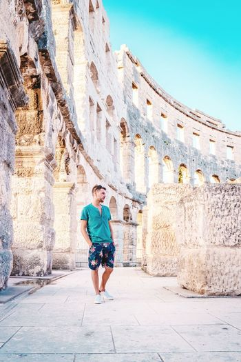 Man Croatia Boy Pula Croatia Pula Arena Pula Croatia EyeEm Selects City Full Length Men Sportsman Summer History Sky Archaeology Old Ruin Amphitheater Ancient The Past Ruined Ancient Civilization Ancient Rome Civilization