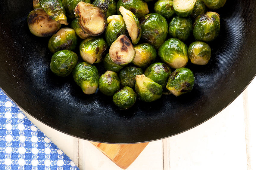 Sautéed Brussels Sprouts in wok. Green Green Color Roasted Brussel Sprouts! Vegetarian Vegetarian Food Blue Napkin Braised Brussels Sprout Cruciferous Food Food And Drink Freshness Green Color Healthy Eating Healthy Lifestyle No People Roasted Sauteed Sauteed Veggies Studio Photography Vegan Vegan Food Vegetable White Background Wok