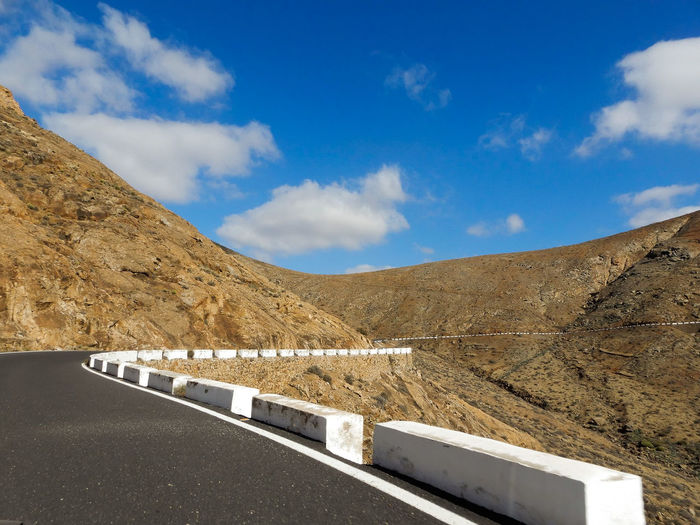 road to the top... Colors Colorful Nature Lines, Shapes And Curves LINE Road Roadtrippin Pass Mountain Desert Sky Architecture Cloud - Sky Empty Road Mountain Road Asphalt Roadways White Line
