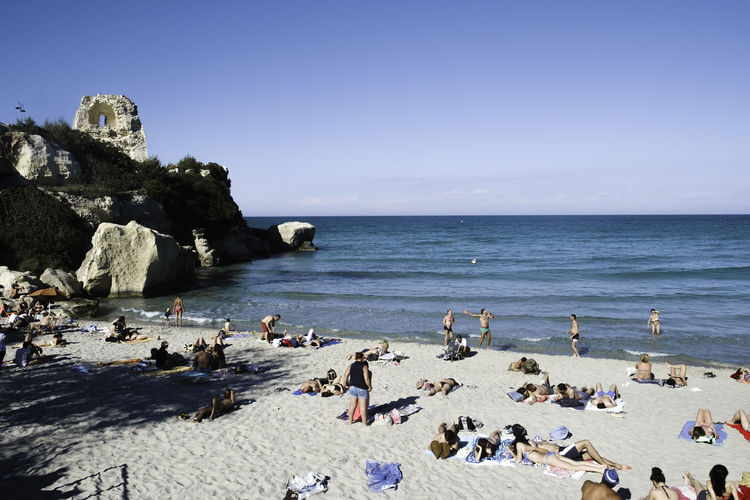 Tourism Tourist Destination Beach Beauty In Nature Blue Clear Sky Cliff Day Horizon Over Water Italy Large Group Of People Live For The Story Melendugno Summer Sunny Nature Outdoors People Rock - Object Salento Scenics Sea Sky Swimming Travel Destinations Water