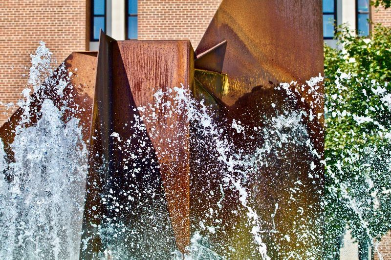 Close-up of fountain by building