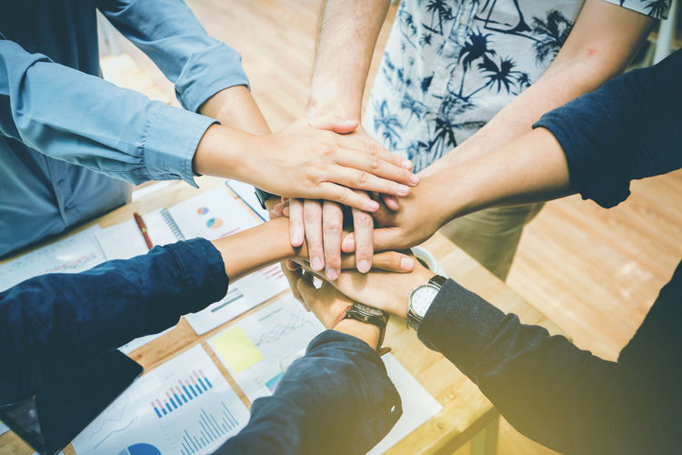 Adult Body Part Connection Cooperation Finger Friendship Group Group Of People Hand High Angle View Human Body Part Human Hand Medium Group Of People Men People Real People Standing Teamwork Togetherness Unity Women