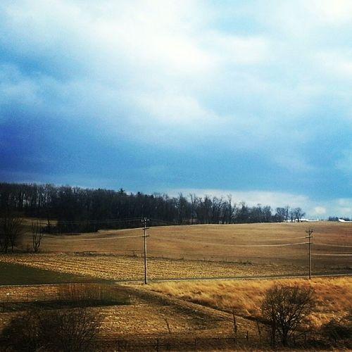Farmville Farm Fields Squares Divides sky landscape mountains trees sloping crops dormant