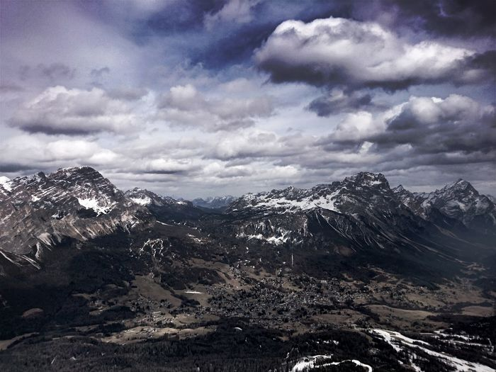 Scenic view of storm clouds over mountains
