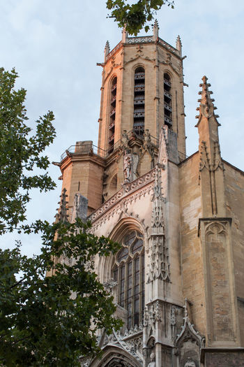 Cathedral of San Salvador (Saint-Sauveur), Aix-en-Provence Arch Architecture Building Exterior Built Structure Church Day High Section Historic History Low Angle View No People Outdoors Place Of Worship Sky Tall Tall - High Tower Tree Window
