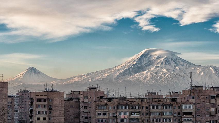 The mountain Ararat towering above Yerevan's housing. Ararat  Architecture Armenia Building Exterior Built Structure City Cityscape Cloud - Sky Day Landscape Mountain Nature No People Outdoors Scenics Sky Snow Travel Destinations Urban Skyline Yerevan The Great Outdoors - 2018 EyeEm Awards
