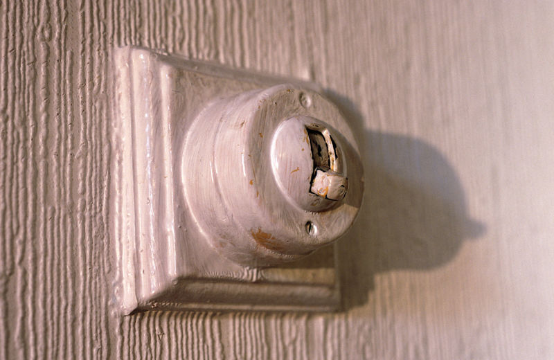 Close-up of old light switch on wall