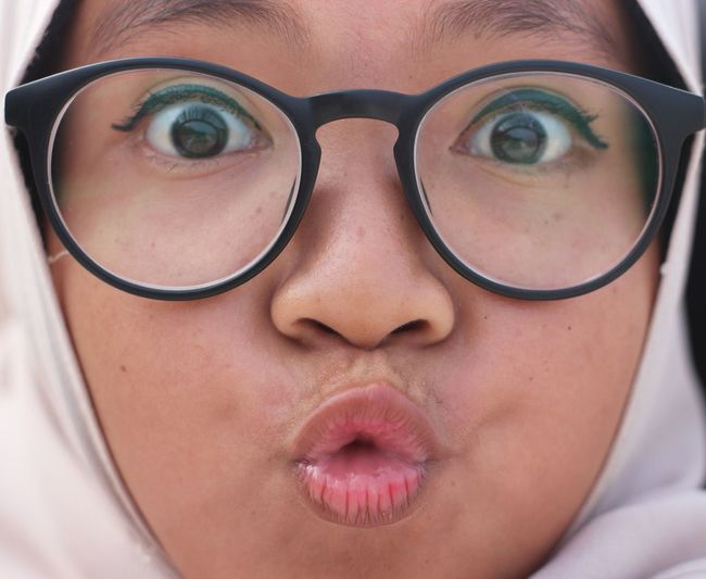 Close-up portrait of girl wearing eyeglasses