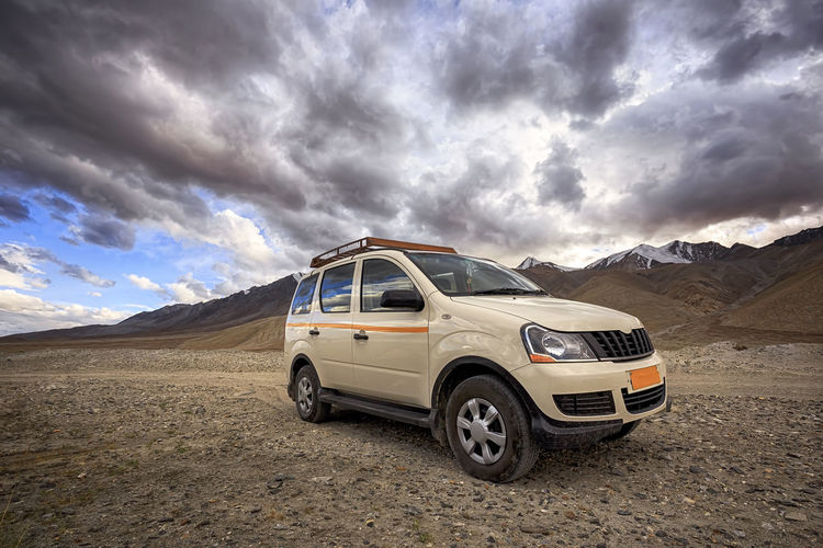 travel on the car. famous Pangong tso (Lake). It is huge lake in Ladakh, altitude 4,350 m (14,270 ft). It is 134 km (83 mi) long and extends from India to Tibet. Leh, Ladakh, Jammu and Kashmir, India. ASIA Holiday Kashmir , India Ladakh Adventure Beauty In Nature Car Car Travel Cloud - Sky Day Desert Dramatic Landscape Extream Park Himalaya Landscape Montains    Mountain Nature No People Outdoors Scenics Sky Storm Cloud Transportation Vacation