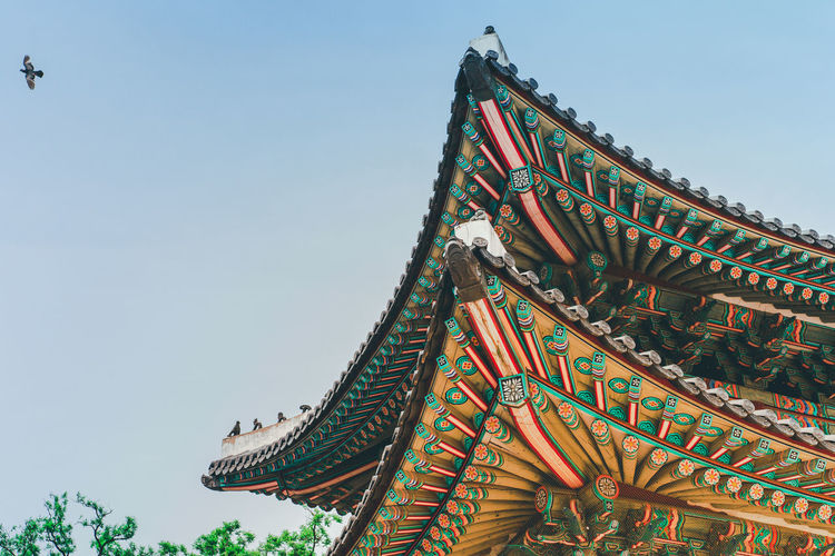 Low angle view of traditional building against sky in korea