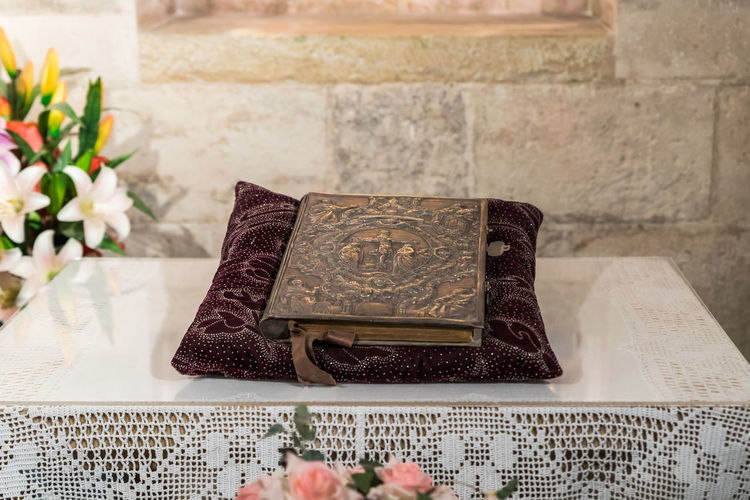 Jerusalem, Israel, March 09, 2019 : The sacred book lies on a pillow in the prayer room in the cave in the Church of Saint Anne near Pools of Bethesda in the old city of Jerusalem, Israel Tank Roman Cistern Heritage Historic Brick Wall Stone Material Damaged Arch Remains Landmark Ruins Christianity Excavations Scenic View Ancient Archaeological Religion And Beliefs Culture Antique Architecture Jerusalem Israel Old City Church Of Saint Anne And The Pools Of Bethesda Worship