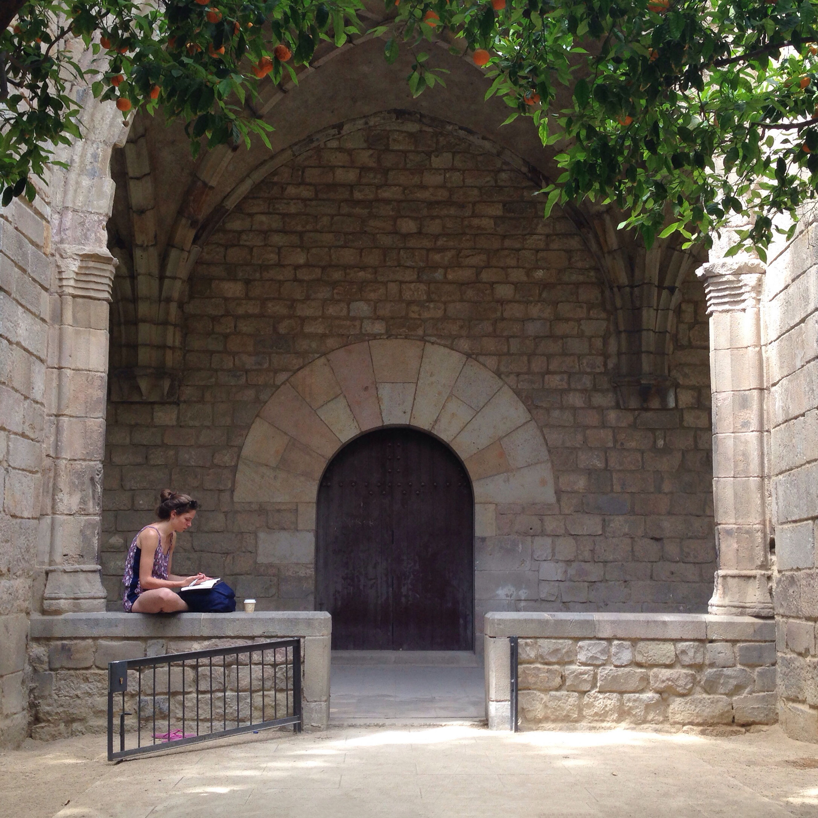 architecture, built structure, arch, building exterior, lifestyles, entrance, leisure activity, person, full length, steps, men, sitting, stone wall, cobblestone, day, rear view, history