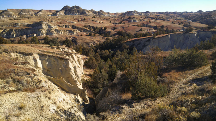 North Dakota Badlands Canyons Terrain Grassland Rolling Landscape Remote Wilderness Silence Solitude Beauty In Nature Rock Rock Formation Environment Tranquil Scene No People Land Arid Climate Outdoors Tranquility Scenics - Nature Landscape Hiking Exploring