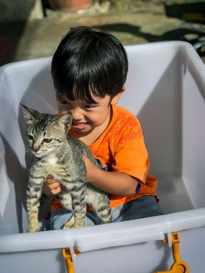 Domestic Cat Pets Domestic Animals Childhood One Person Sitting Mammal Real People Feline Cute Boys Indoors  Playing One Animal Happiness Child Animal Themes Lifestyles Smiling Portrait Be. Ready. Perspectives On Nature Rethink Things EyeEmNewHere