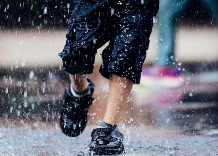 Our feet take us places as does our mind. Vow to travel more (Foot Traffic: a series). Wet Motion Childhood Human Body Part Child People Drop Splashing Human Limb Body Part Rain