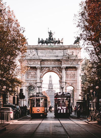 trams in milan with the arch and castle in fall Architecture Mode Of Transportation Transportation Arch Built Structure City Triumphal Arch Travel Land Vehicle Tree Street Travel Destinations Nature History The Past Incidental People Motor Vehicle Plant Tourism Building Exterior Outdoors Tram Autumn Colors Mood