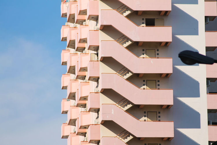 urban pink Pink Building Urban Geometry Urbanphotography Pattern, Texture, Shape And Form Geometric Architecture Apartment City Building - Activity Residential Building Business Finance And Industry Home Ownership Housing Development Community Architecture Sky Skyscraper Tall - High Skyline The Architect - 2018 EyeEm Awards