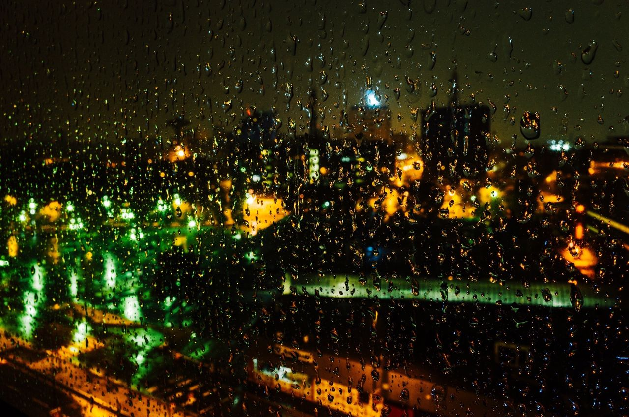 illuminated, night, wet, rainy season, rain, drop, raindrop, no people, architecture, water, window, indoors, building exterior, city, cityscape, close-up, sky, nature