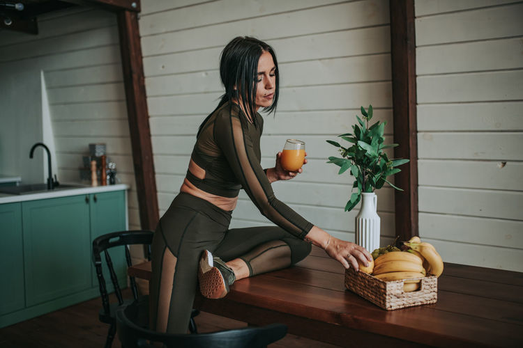 Woman holding food at home