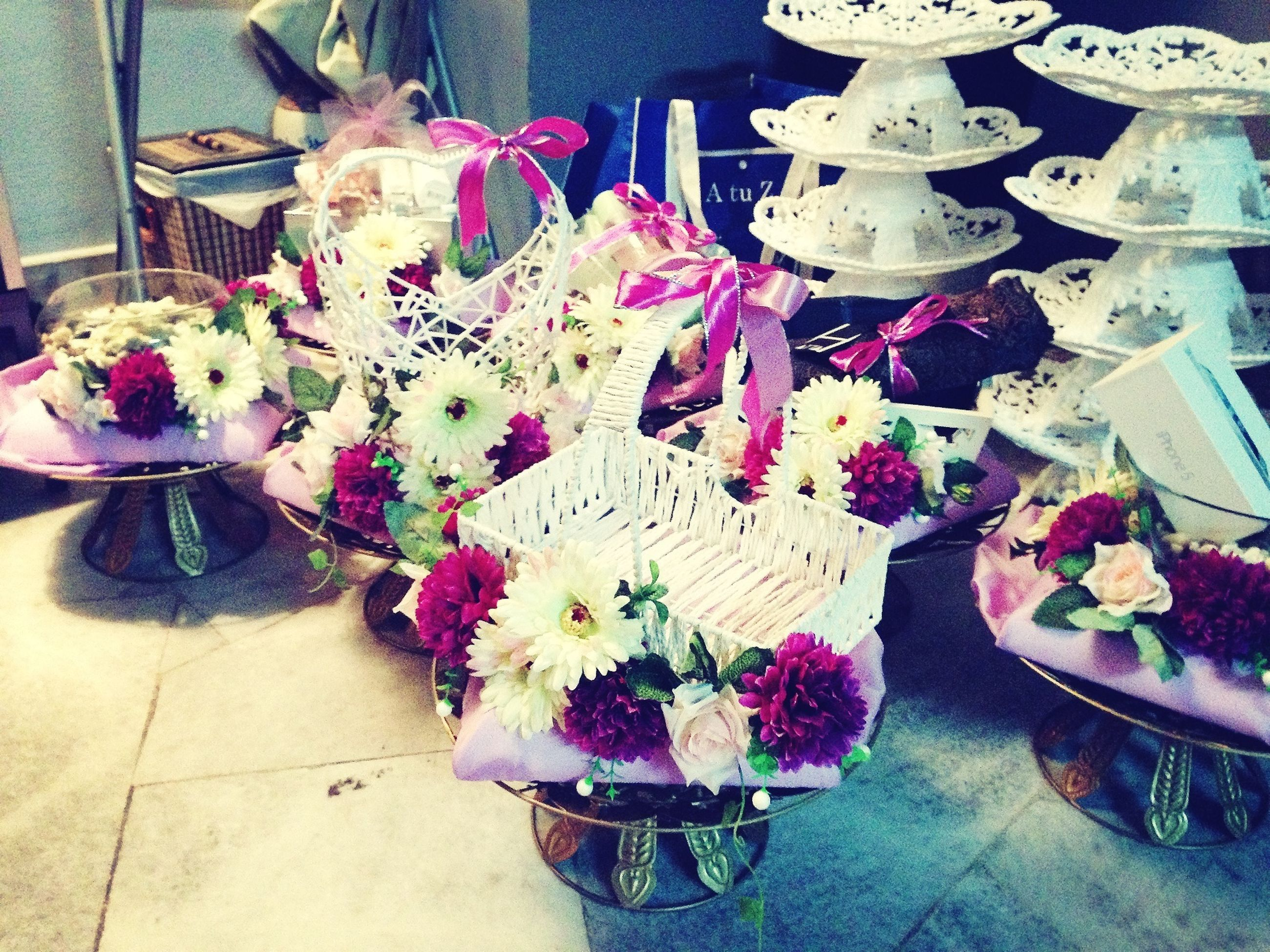flower, indoors, freshness, decoration, vase, bouquet, variation, petal, potted plant, multi colored, fragility, high angle view, bunch of flowers, table, flower arrangement, flower pot, plant, arrangement, pink color, flower head