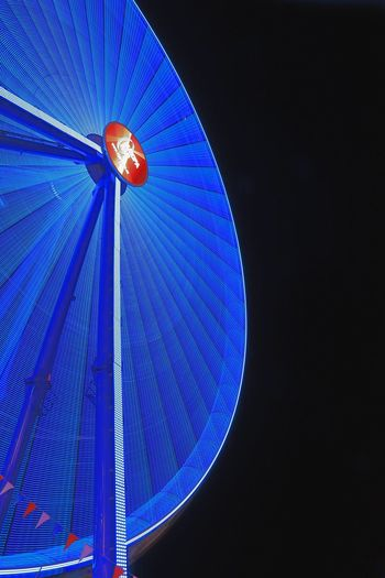 blaues Riesenrad Riesenrad Amusement Park Amusement Park Ride Arts Culture And Entertainment Black Background Blue Ferris Wheel Illuminated Low Angle View Multi Colored Night No People Outdoors Sky Spinning A New Perspective On Life Capture Tomorrow