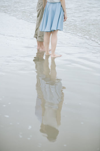 Low Section Human Leg Reflection Body Part Women Water Standing Human Body Part Leisure Activity Day Adult barefoot Real People Nature Lifestyles Outdoors Human Foot Human Limb Reflected Picture Couple Couple In Love Sea Beach Beachphotography Standing Water Standing Sand Dune