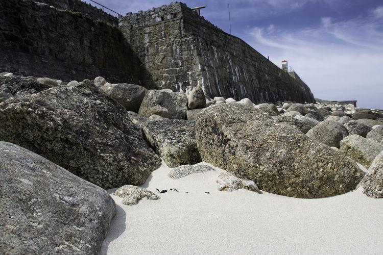 Rocks on shore against sky