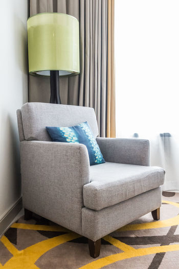 Armchair Day Domestic Room Electric Lamp Furniture Home Interior Home Showcase Interior Indoors  Living Room Modern Multi Colored No People Pillow Seat Side Table Sofa