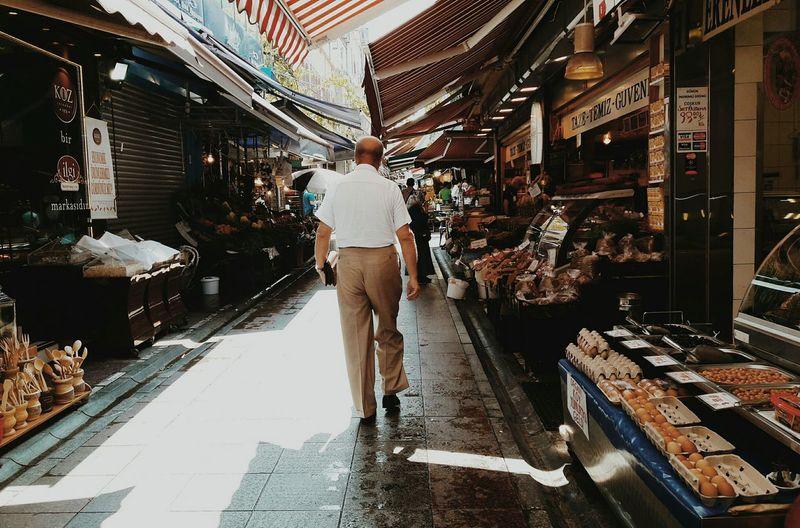 Full length of people walking on street
