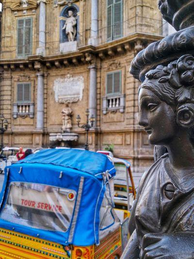 Close-up of statue against quattro canti