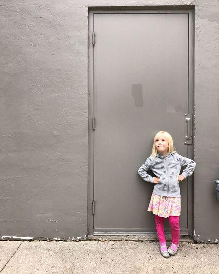 Full Length Of Girl Standing Against Door
