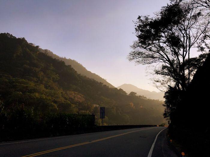 追不上太陽了⋯⋯ Tree Plant Sky Transportation Mountain Road Nature No People Beauty In Nature Scenics - Nature Direction Tranquility Symbol Road Marking The Way Forward Environment Sunset Sign Silhouette Growth