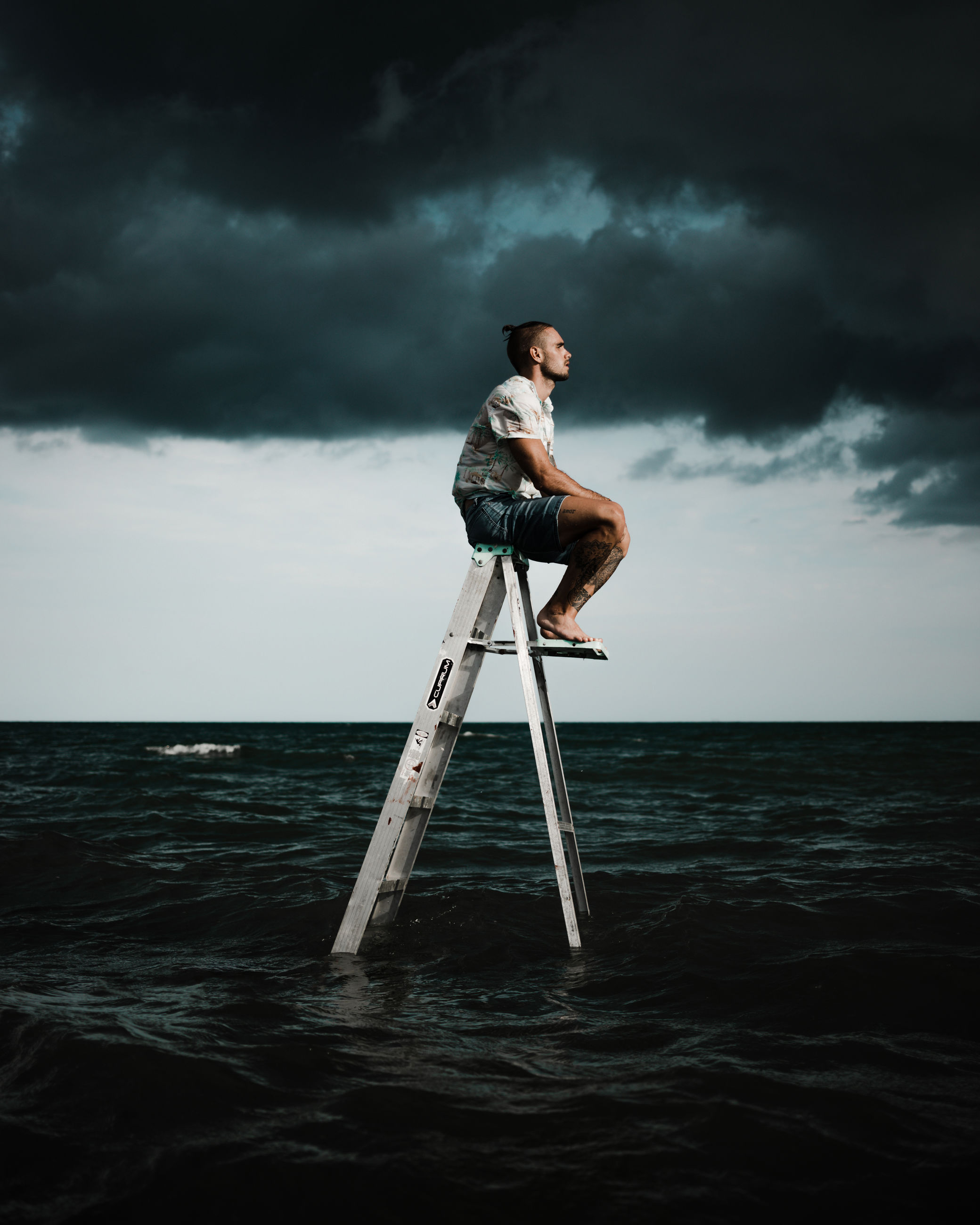 cloud, sky, water, one person, sea, adult, full length, nature, men, horizon, ocean, storm, wave, horizon over water, storm cloud, darkness, overcast, beauty in nature, standing, land, young adult, side view, person, outdoors, dramatic sky, wind, scenics - nature, sports, motion, cloudscape, occupation, dusk, copy space
