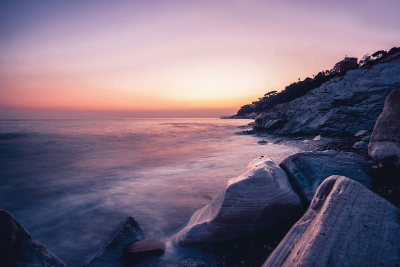 Liguria Italy Varazze Water Sky Sea Sunset Scenics - Nature Beach Beauty In Nature No People Rock - Object Idyllic Motion Nature Tranquility Tranquil Scene Breaking Horizon Over Water Horizon Land Rock Solid