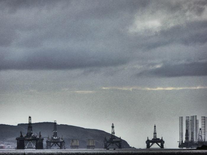 Commercial dock against sky at dusk